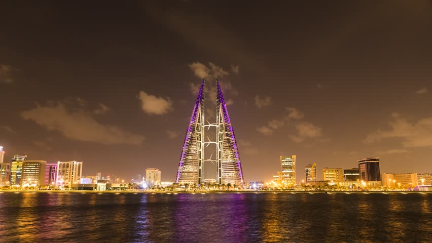MANAMA, BAHRAIN - October , 2018: Time lapse view of the illuminated World Trade Center and other high rise buildings in Manama on Oct 28, 2017 in Manama, Bahrain