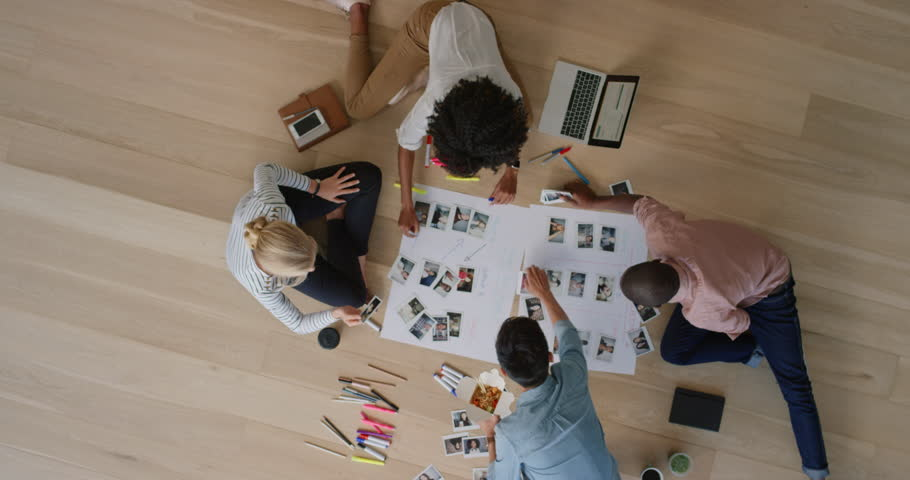 young multi ethnic business people brainstorming planning team building event sharing creative ideas together teamwork collaboration overhead #1018897699