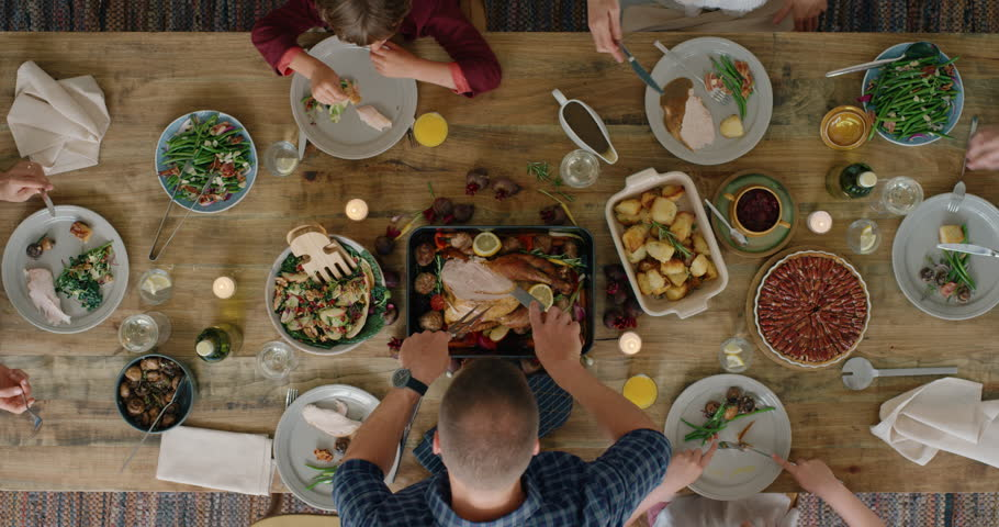 happy family eating thanksgiving lunch together enjoying healthy homemade feast holiday celebration holiday meal overhead tracking #1018898260