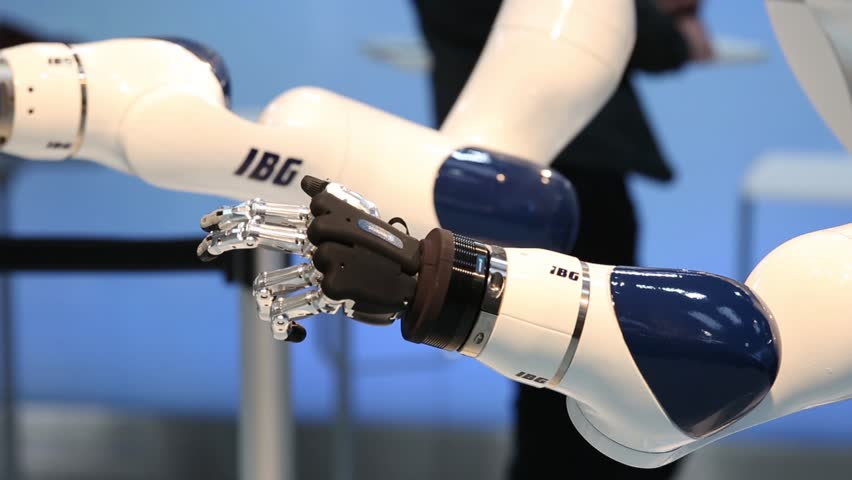 Hannover, Germany - April, 2018: IBG presenting robot and human collaboration on Messe fair in Hannover, Germany #1018924453