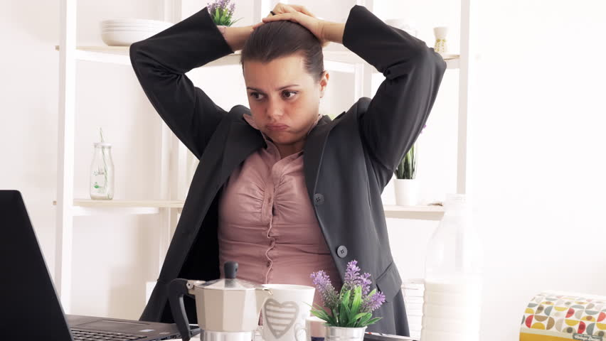 Business woman unhappy pulling back hair in ponytail  #1018990684