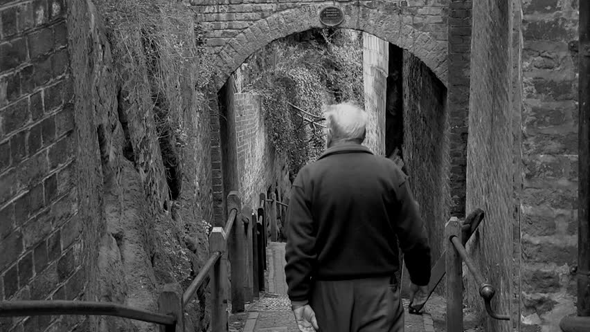 Old man walking down steps in Bridgnorth, in the United Kingdom Both Color and black and white versions from 5, 10, 15 seconds to long version. #1019012191