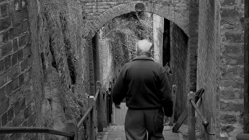 Old man walking down steps in Bridgnorth, in the United Kingdom Both Color and black and white versions from 5, 10, 15 seconds to long version. #1019012194