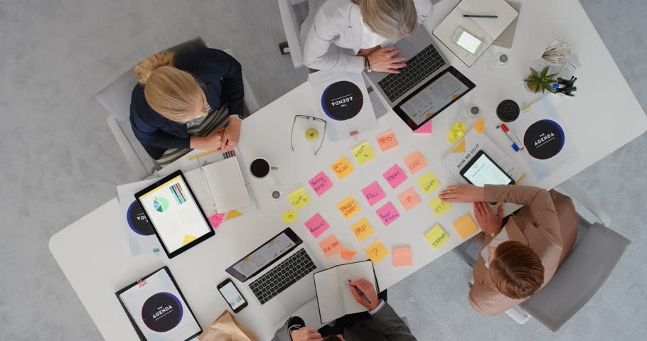 group of diverse business people working together brainstorming strategy for innovative company making notes using colorful paper in boardroom meeting top view #1019015359