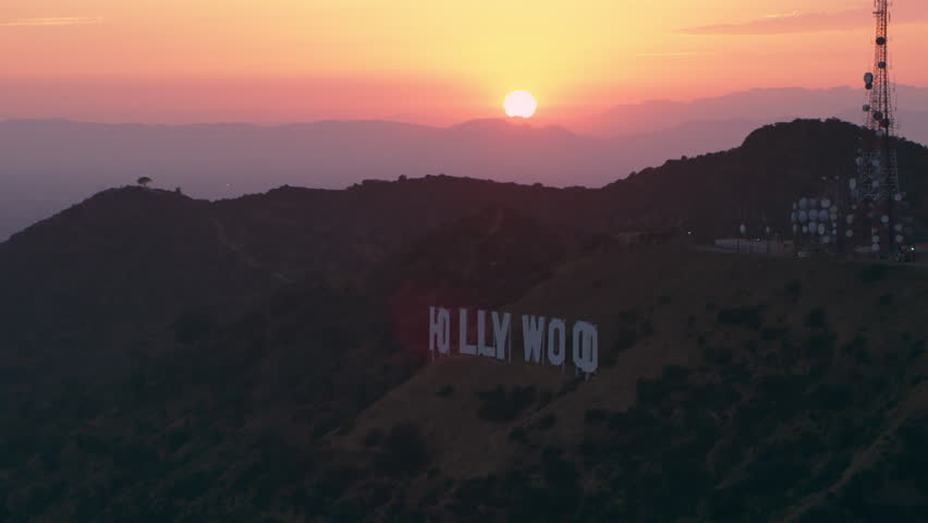 Los Angeles California CIRCA-2018. Flying in Los Angeles amongst The Hollywood Hills, Hollwyood sign and mountains. Wide shot on 4k RED camera.