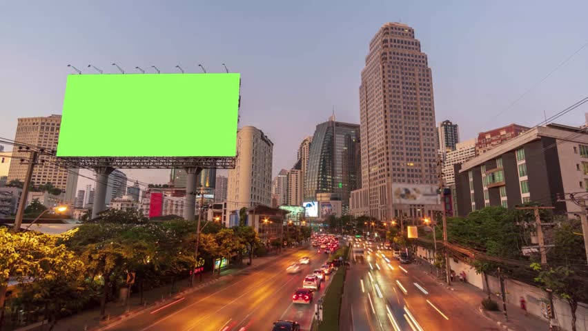 Time lapse: Billboard with green screen and city traffic light background at day to night. 4K Resolution. | Shutterstock HD Video #1019019427