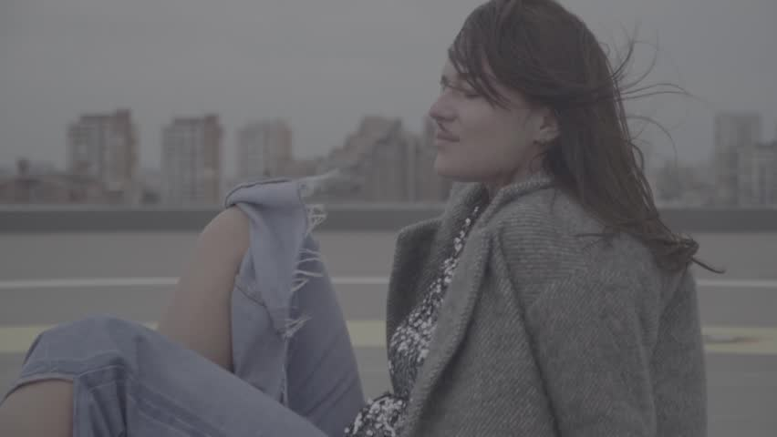 Cute woman on the view of city on background. Slow motion, s-log | Shutterstock HD Video #1019027500