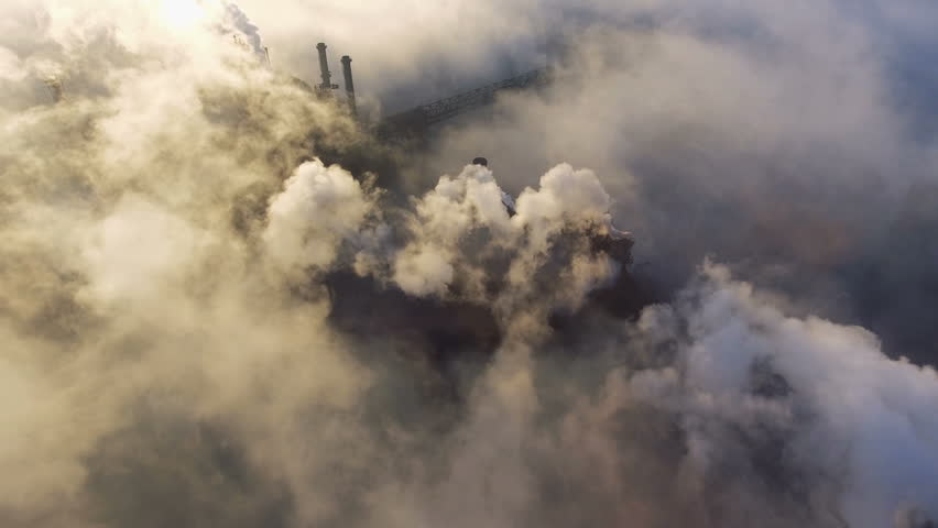 Aerial view over industrialized city. pollution from metallurgical plant. Dirty smoke and smog from pipes of steel factory and blast furnaces. Ecological | Shutterstock HD Video #1019031382