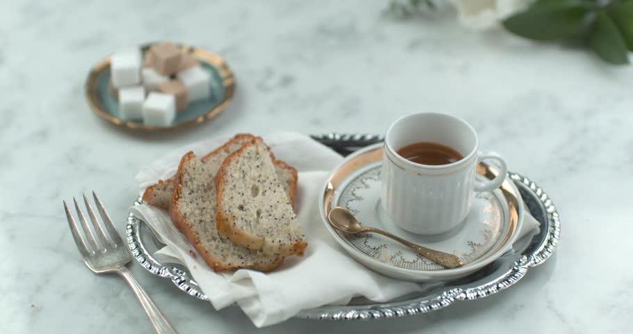 Fancy English tea and cake served on silverware closeup with 4k Phantom Flex camera