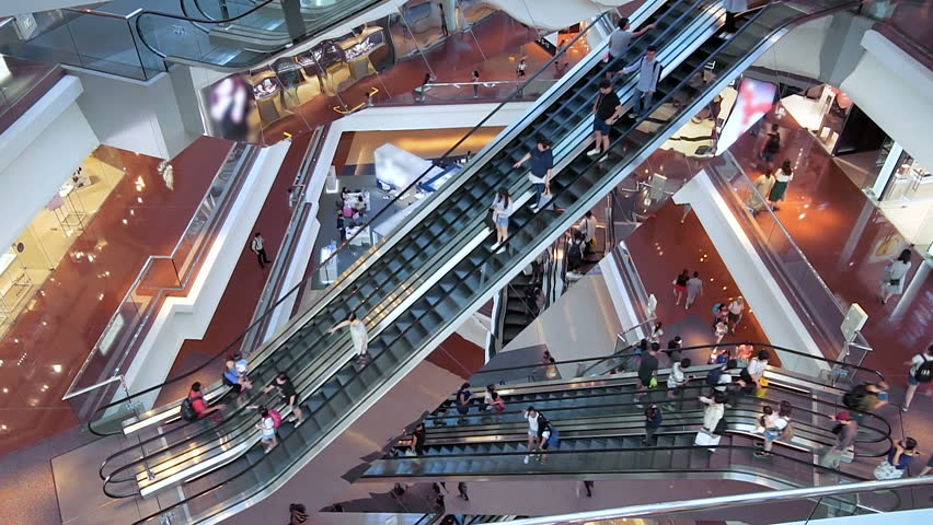 HONG KONG, CHINA - CIRCA NOVEMBER, 2018: Time lapse escalators in modern shopping mall crowd of people. Very busy full of clients mall complex. Consumption concept   Shutterstock HD Video #1019119648