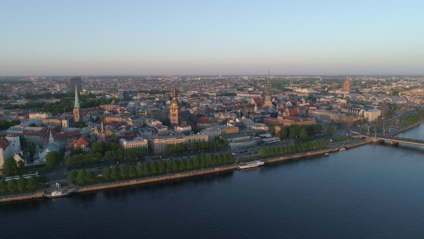 Aerial drone shot of Riga Old Town with Riga skyline in background | Shutterstock HD Video #1019123434
