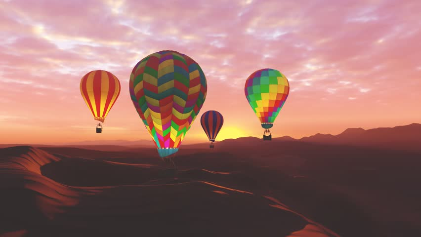 Colorful hot air balloons flying over mountains and desert landscape during sunset. Four large multi-colored balloons slowly rising against a beautiful cloudy pink sky. Travel, adventure, festival.