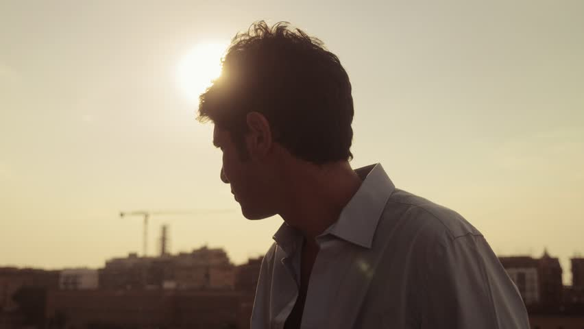 Pensive man smoking electronic cigarette and contemplating the sunset on city | Shutterstock HD Video #1019145643