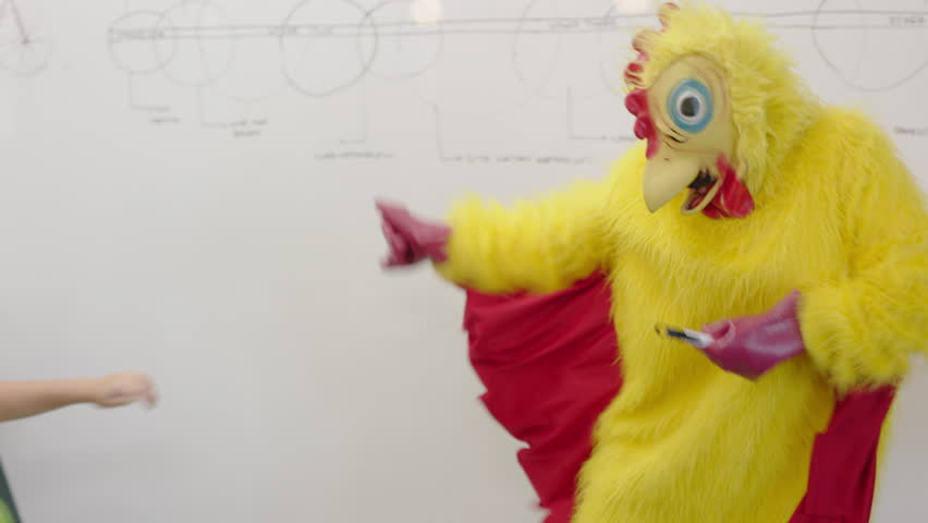 Dancing chicken happy business students enjoying funny dance party in boardroom meeting celebrating successful victory crazy rooster high five colleagues in excited office presentation
