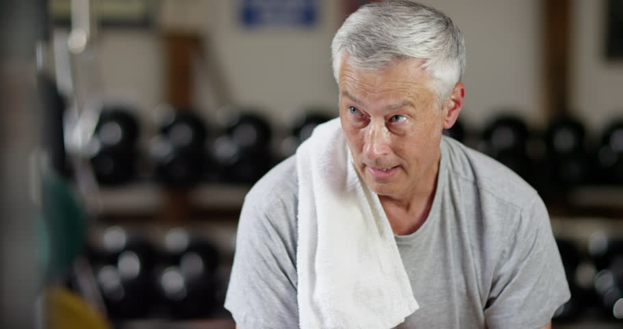 4K Portrait of unfit mature man in the gym, tired & breathing heavy after workout. Slow motion. | Shutterstock HD Video #1019205448
