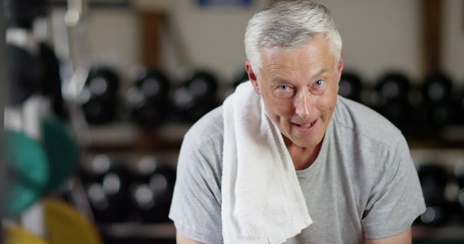 4K Portrait of mature man in the gym, tired & taking a break to get his breath back. Slow motion. | Shutterstock HD Video #1019205451