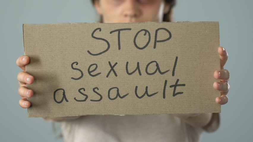 Stop sexual assault poster in bruised woman hands, problem awareness prevention | Shutterstock HD Video #1019218477