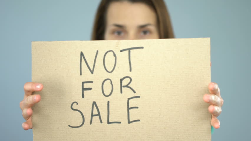 Not for sale on poster in confident woman hands, human trafficking prevention | Shutterstock HD Video #1019218513