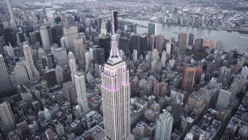 New York City Circa-2015, aerial view orbiting the Empire State Building at dusk with Midtown Manhattan and Central Park in the background | Shutterstock HD Video #1019244523