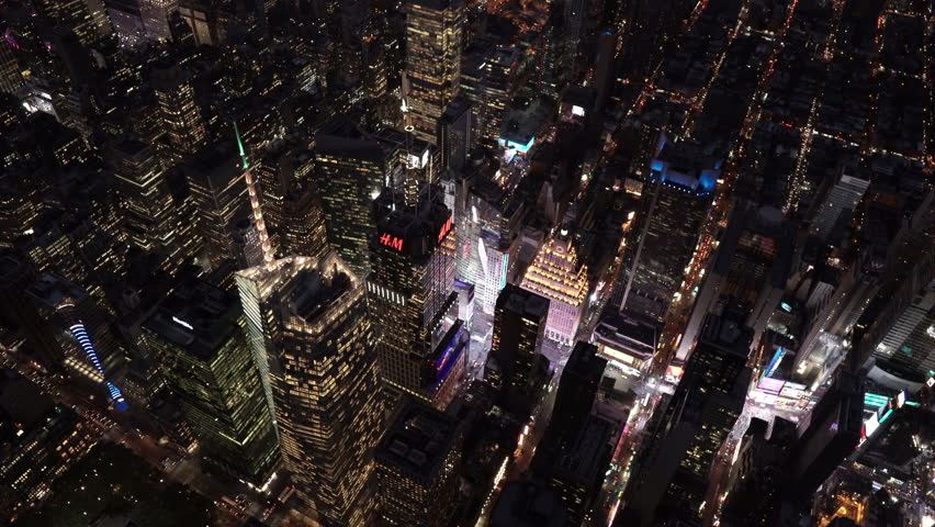 New York City Circa-2015, high angle aerial view flying across Times Square at night