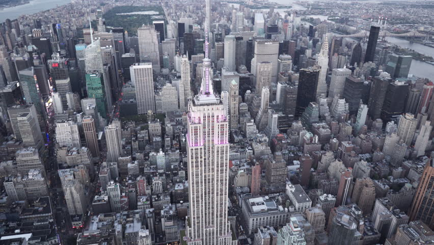 New York City Circa-2015, aerial view orbiting the Empire State Building at dusk with Midtown Manhattan and Central Park in the background | Shutterstock HD Video #1019246179