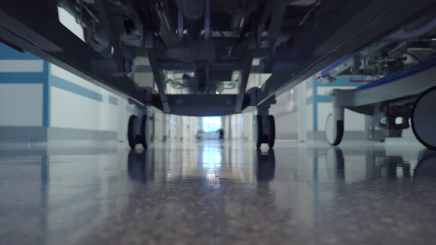 Patient Transportation in Hospital's Hallway on Surgical Bed Royalty-Free Stock Footage #1019250685