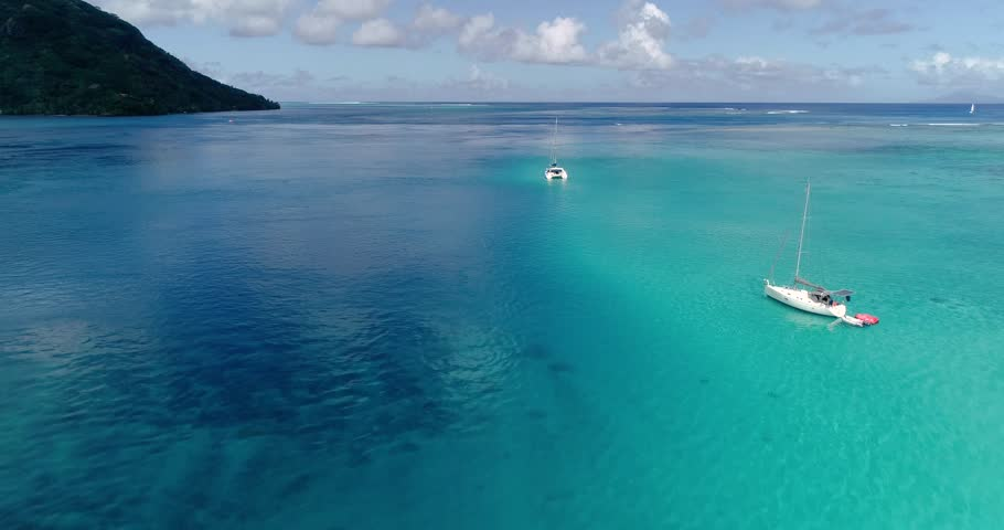 boat in a lagoon in aerial view, French Polynesia #1019267911