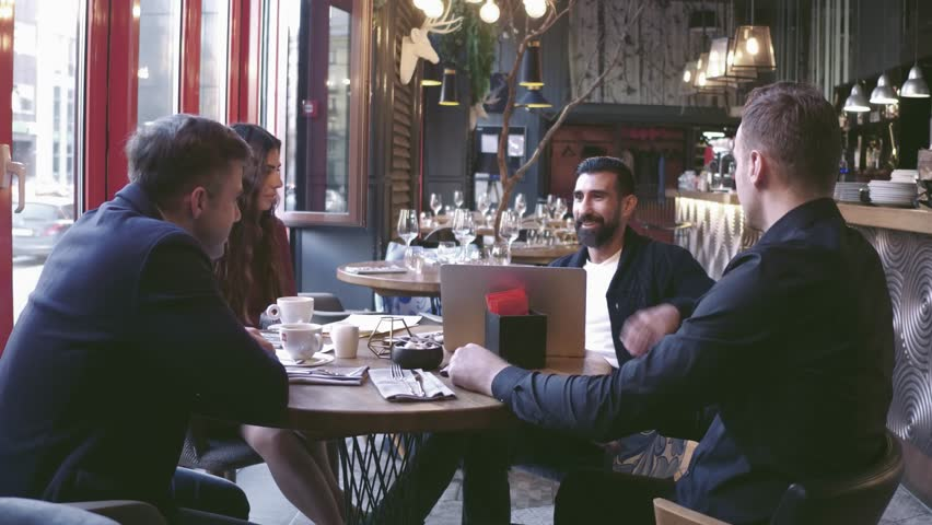 Group Young Business People Gathered Together Discussing Creative Idea at Cafe. Startup Concept Coworkers Meeting.Brainstorming Work Process Office.Using Modern Electronics Gadgets. | Shutterstock HD Video #1019295550