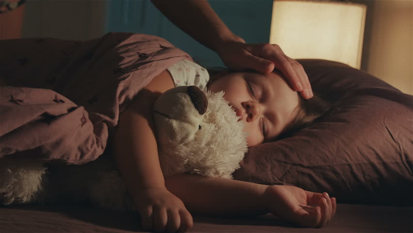 Sleeping baby happy and carefree in bed hugging a teddy bear toy. Mother cover with a blanket her child. Happiness in sleep, children without coughing. Royalty-Free Stock Footage #1019298025