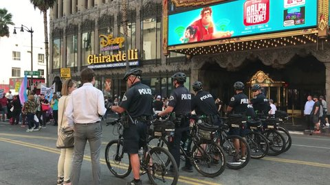 LOS ANGELES, Nov 11th, 2018: Police on bikes are lined up on Hollywood Boulevard in front of the El Capitan while talking to passers-by, during the Second Annual Me Too Survivor's March.