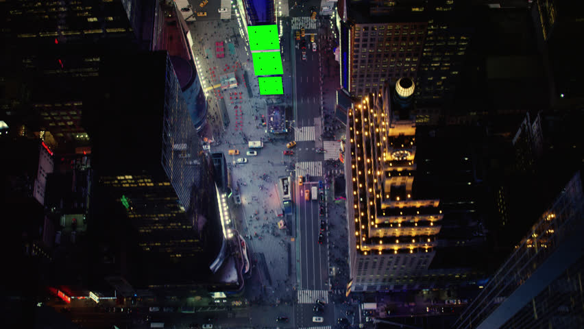 Top down aerial view of busy streets in downtown Manhattan in Times Square, New York City, with bright night lighting. Best New York vfx Aerial shot. Wide shot on 4k RED camera with green screens.