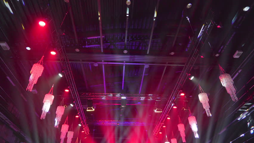 The view of the ceiling of the building with the lights all over and the chandeliers on the side | Shutterstock HD Video #1019338621
