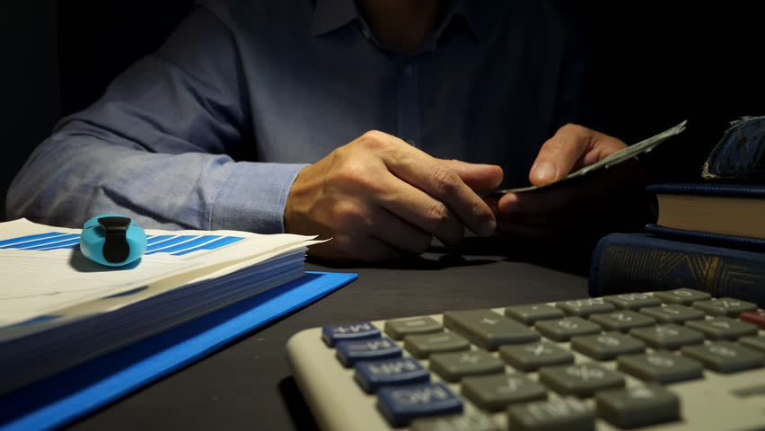 Businessman counting money at the office. Loan concept. | Shutterstock HD Video #1019370421