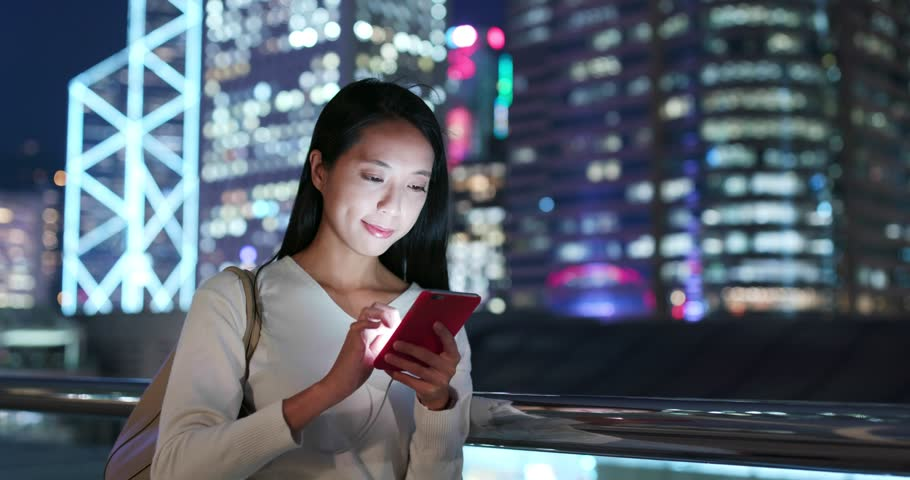 Woman send audio message on cellphone at night   Shutterstock HD Video #1019370481