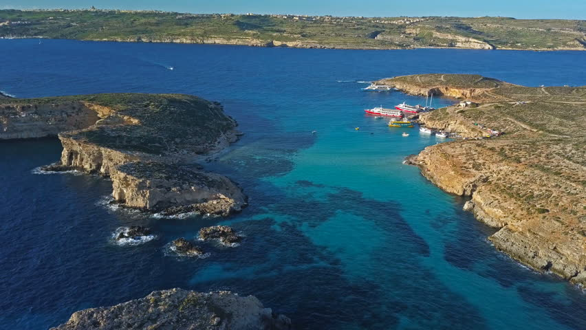 Beautiful aerial view of the Blue Lagoon in the island of Comino, Malta Royalty-Free Stock Footage #1019376319