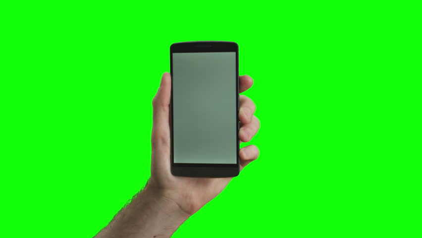 Hand holding the new smartphone on green screen. Extremely high quality. 4K resolution. The newest phone model. You can track it easily putting the trackers on the screen corners.
