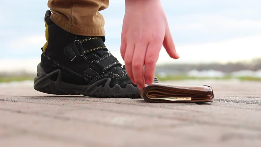 Low angle video shoot of man losing his wallet and little kid picking up it. Real time full hd video footage.   Shutterstock HD Video #1019398414