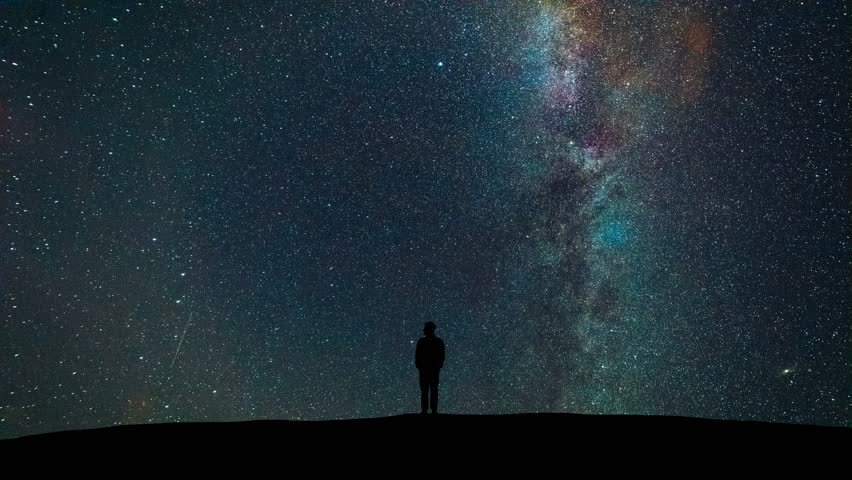 The man standing on the starry sky background. time lapse #1019399593