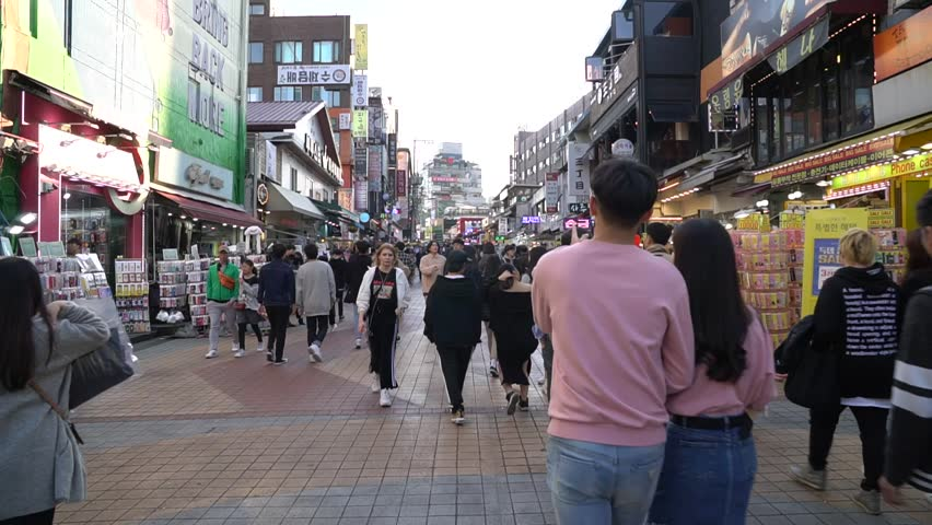 SEOUL SOUTH, KOREA - OCTOBER 21,2018 : Timelapse crowd of people in Hongdae(Hongik University) shopping street. Hongdae is a shopping cultural street for young people in Seoul. #1019435998