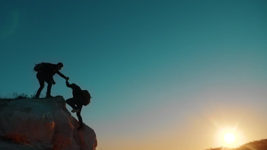 Teamwork help business travel silhouette slow motion video concept. Helping hand silhouette between two climbers. teamwork group of tourists lends a helping hand climb the cliffs mountains. couple man | Shutterstock HD Video #1019465446
