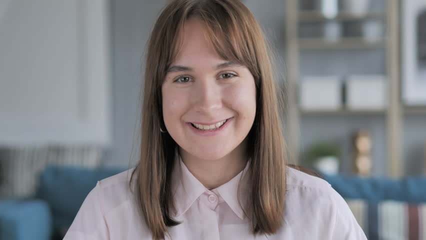 Portrait of Smiling Positive Casual Young Girl | Shutterstock HD Video #1019492554