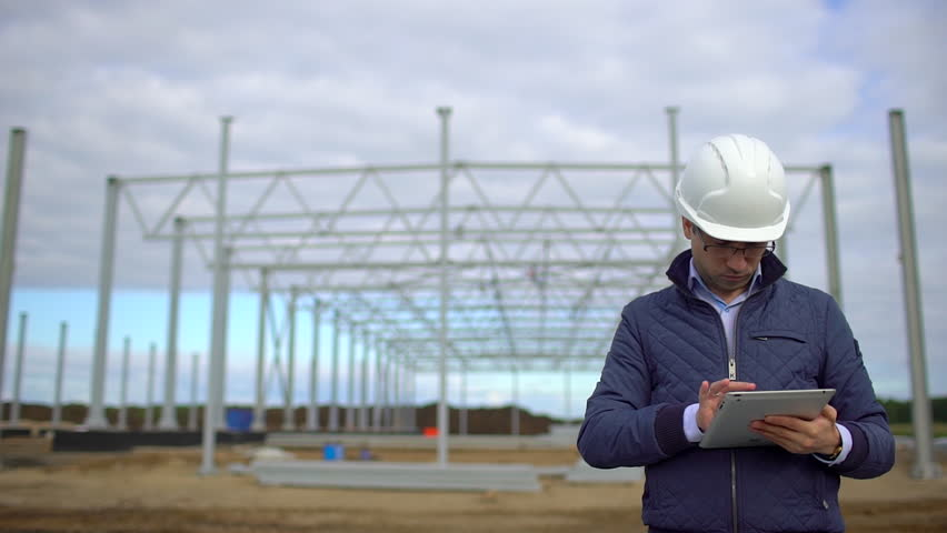 Male construction engineer architect supervisor in hard hats working checking quality using laptop, tablet computer in construction site Businessman engineers architects man. business and technologies | Shutterstock HD Video #1019501749