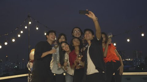People celebration with friends party and photography selfie with smartphone together.