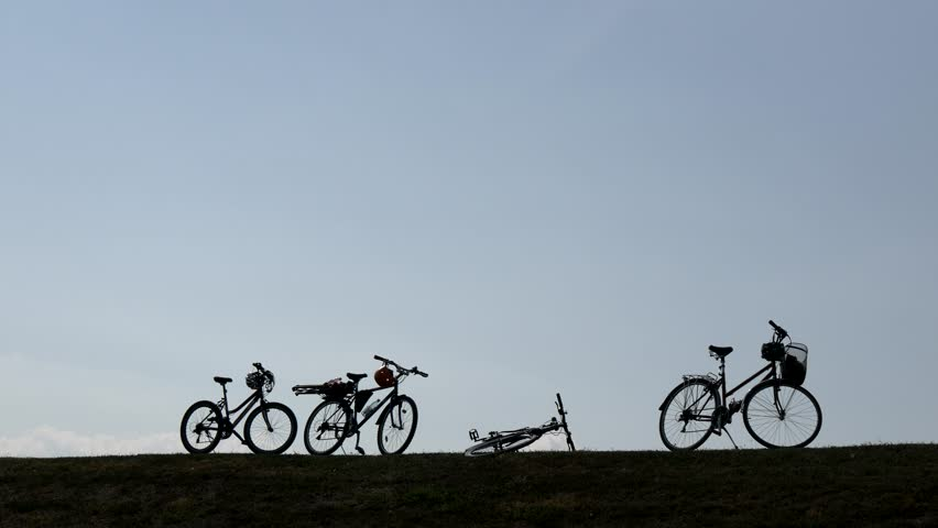 Bicycles Standing And Lying On The Ground (Silhouette)   Shutterstock HD Video #1019531290