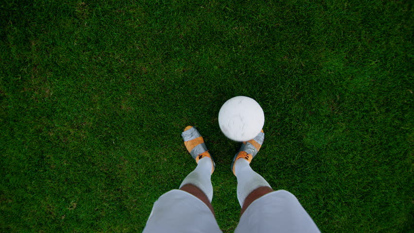 Point of View Shot of Professional Soccer Player Dribbling the Ball, overtaking His Opponents. POV with Focus on Legs.