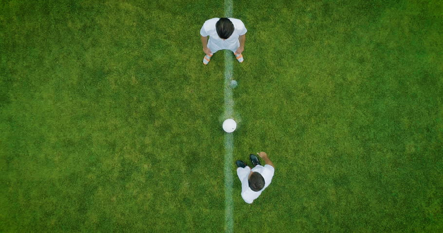 Aerial Top Down View of Soccer Field and Two Professional Teams Playing. Kick off Start of the Energetic Match on International Championship #1019537563