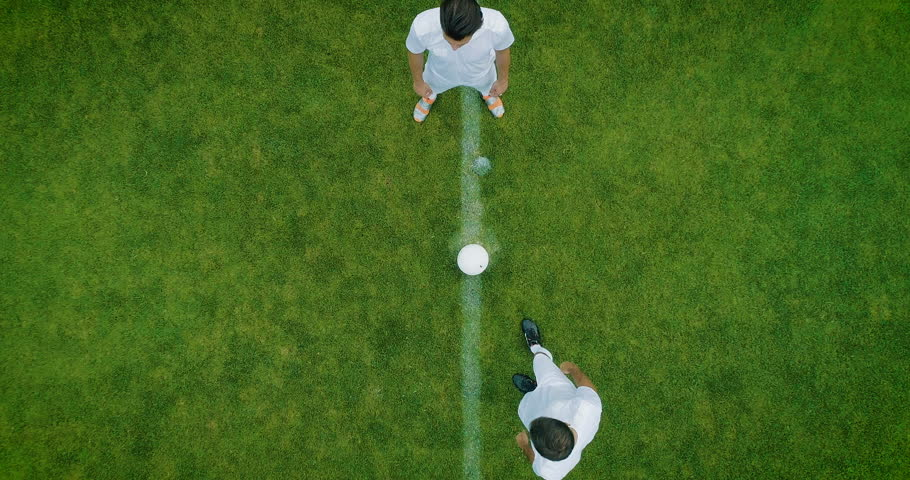 Aerial Top Down View of Soccer Field and Two Professional Teams Playing. Kick off Start of the Energetic Match on International Championship #1019537578