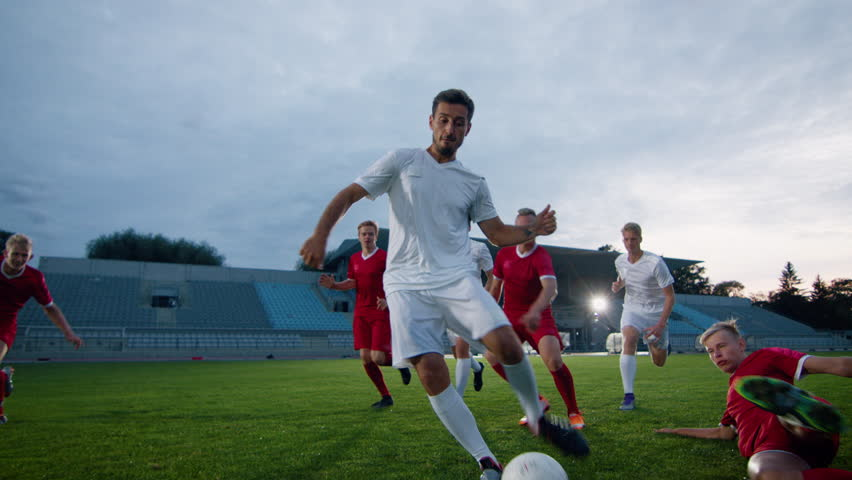 Portrait Shot of Captain of the Soccer Team Celebrates Awesome Victory with His Team, Doing YES Gesture. Team of Celebrate Winning Championship. | Shutterstock HD Video #1019537902
