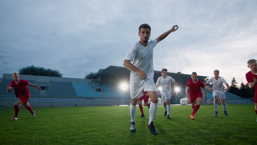 Professional Soccer Player Outruns Members of Opposing Team and Kicks Ball and Scores Goal. His Team Celebrates Victory. Cinematic Slow Motion. | Shutterstock HD Video #1019538163