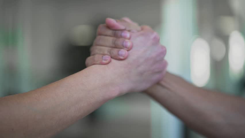 Hands of men high five closeup Two hands takes each other in friendly way Royalty-Free Stock Footage #1019545771